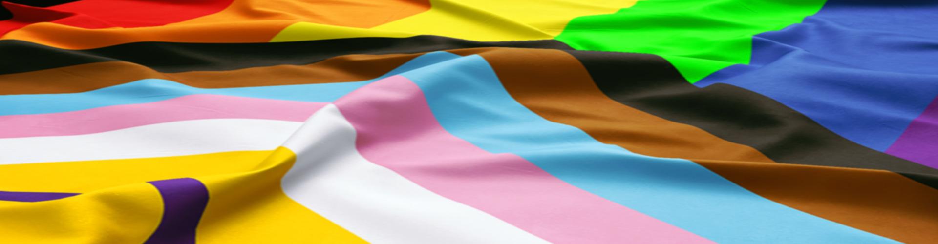 Draped Inclusive Pride flag