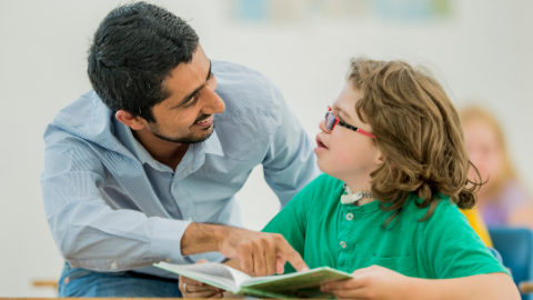 an adult reading a book with a child