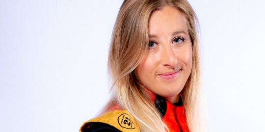 Woman in a motor racing outfit