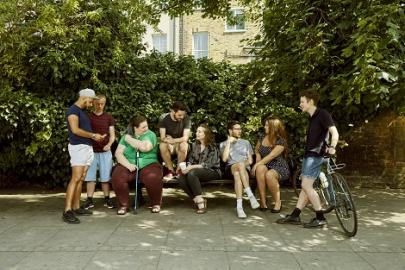 Group of people chatting on a bench
