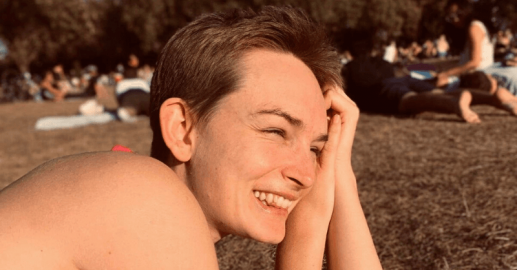 Person smiling in a sunny park