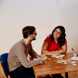 Two people at a table
