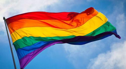 Rainbow flag blowing in breeze