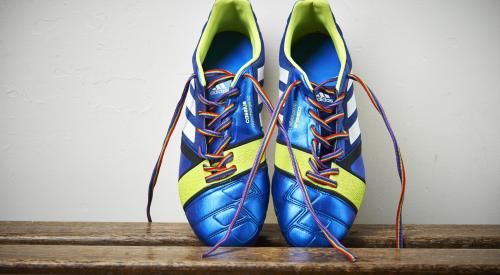 Trainers laced up in Rainbow Laces