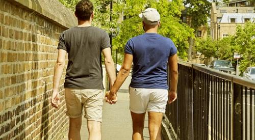 Two people walking hand in hand
