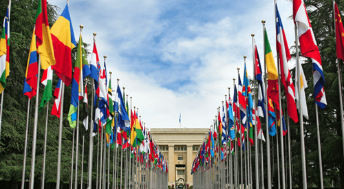 Picture of flags outside the UN building in Geneva