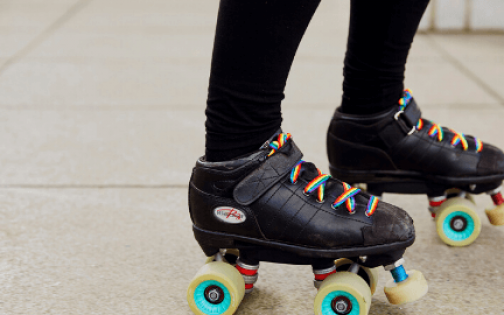 Person in roller skates wearing rainbow laces