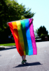 Person holding a rainbow flag