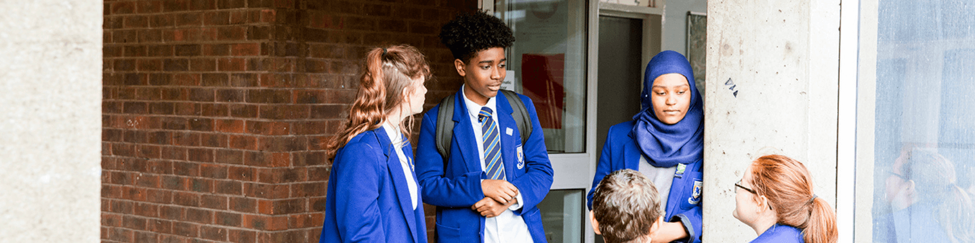 Group of young people outside a school