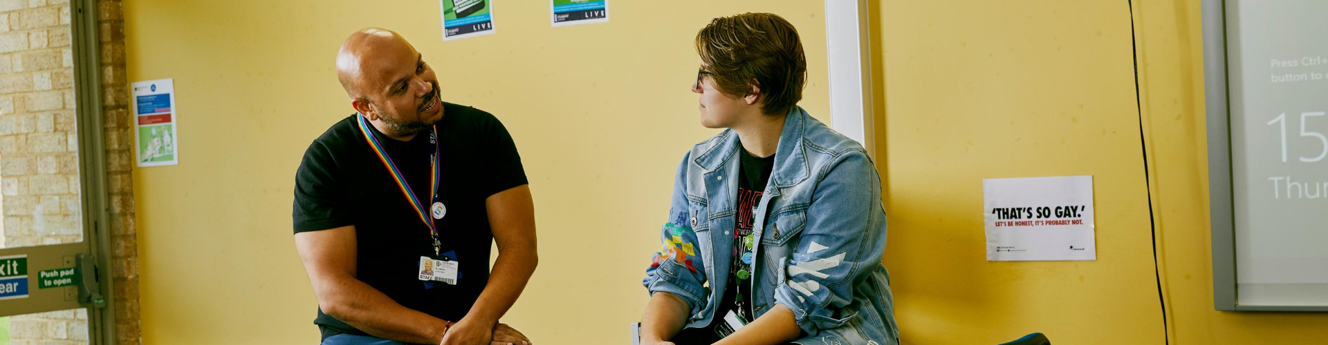 A member of staff talking to a young person